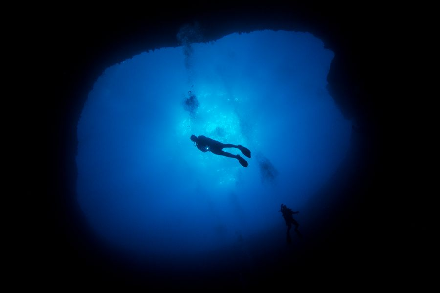 A diver in the Lost Blue Hole outside Nassau, Bahamas