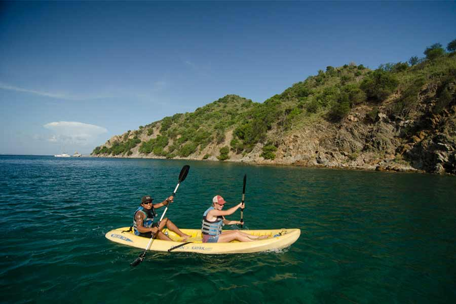 2 passengers off the dive liveaboard Cuan Law kayaking to a island in the BVI