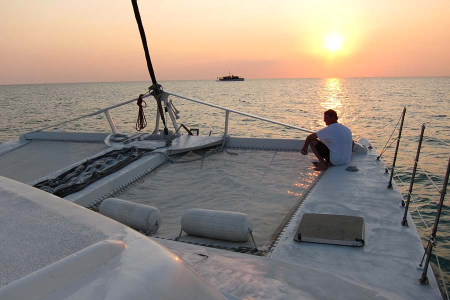 Cat Ppalu at sunset. The Cat Ppalu is a charter sailing yacht in the Exumas, Bahamas