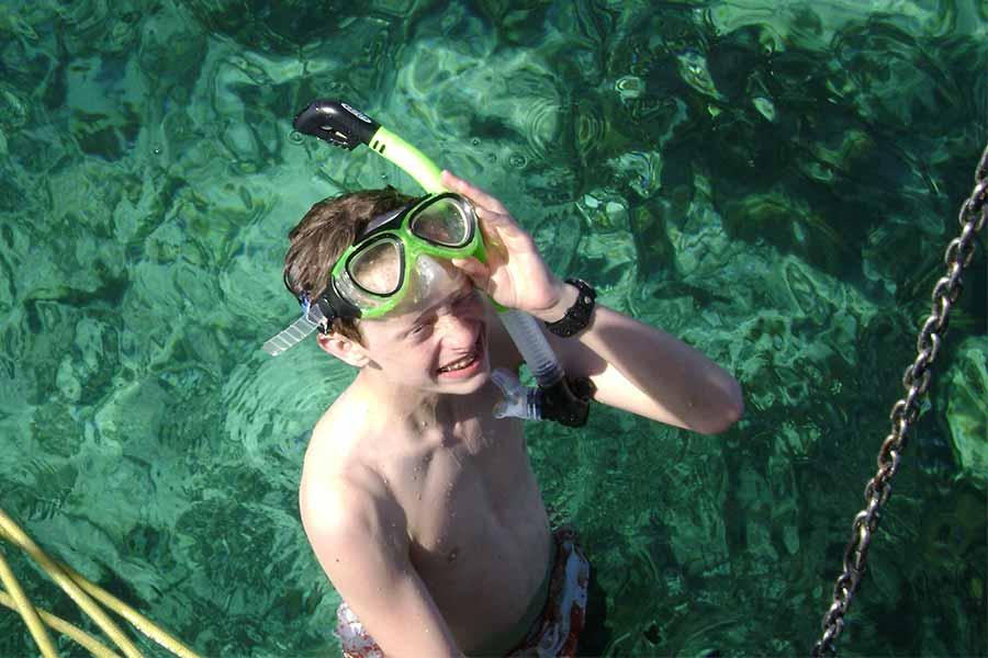 A boy scout snorkeling off the dive liveaboard Sea Explorer
