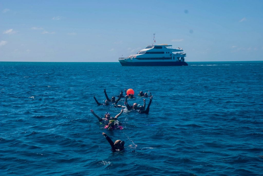 Dive liveaboard Aqua Cat picking up divers after doing the drift dive Washing Machine in the Exumas.