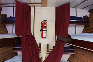 Single berths in the bow compartment on one of the sailboat Morning Star, one of the Blackbeard dive liveaboards.