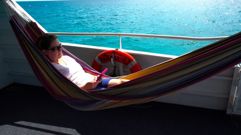Relax in the hammock aboard Aqua Cat Bahamas dive liveaboard
