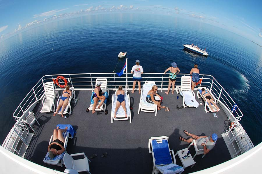 The sundeck on the Bahamas dive liveaboard Aqua Cat. It launch, the Sea Dog is behind the Aqua Cat.