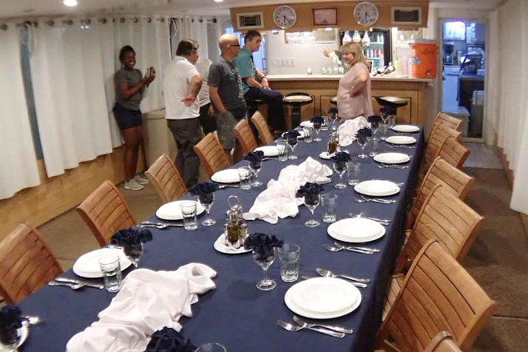 Getting ready to serve dinner on the dive liveaboard All Star Avalon II. Passengers eat well on their dive trip.